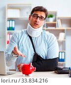 Купить «The businessman with broken arm working in office», фото № 33834216, снято 12 июля 2020 г. (c) easy Fotostock / Фотобанк Лори