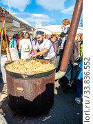 Купить «Cooking appetizing traditional oriental pilaf in a large cauldron», фото № 33836552, снято 5 октября 2019 г. (c) FotograFF / Фотобанк Лори