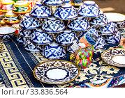 Купить «Ethnic Uzbek ceramics tableware on the table», фото № 33836564, снято 5 октября 2019 г. (c) FotograFF / Фотобанк Лори
