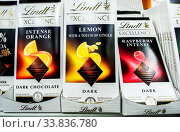 Купить «Lindt Exellence assorted chocolate bars on the shelf in grocery store», фото № 33836780, снято 21 декабря 2019 г. (c) FotograFF / Фотобанк Лори