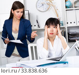 Angry boss screaming to young female manager during working. Стоковое фото, фотограф Яков Филимонов / Фотобанк Лори