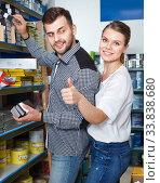 Купить «Young couple are looking instruments for house renovating in paint store», фото № 33838680, снято 17 мая 2018 г. (c) Яков Филимонов / Фотобанк Лори