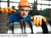 Male engineer works with turbine on factory. Стоковое фото, фотограф Tryapitsyn Sergiy / Фотобанк Лори