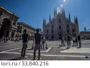 Купить «The 'Giro d'Italia' (Tour of Italy) of the delle Frecce Tricolori (Tricolor arrows) above the Milan Cathedral to remember the victims of the Covid-19 epidemic...», фото № 33840216, снято 23 мая 2020 г. (c) age Fotostock / Фотобанк Лори