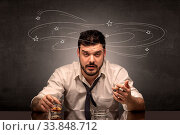 Купить «Young drunk man at his office with doodles around», фото № 33848712, снято 4 июля 2020 г. (c) easy Fotostock / Фотобанк Лори