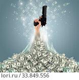 Купить «Hand bursting out from a huge money pile», фото № 33849556, снято 7 июля 2020 г. (c) easy Fotostock / Фотобанк Лори