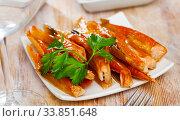 Купить «Smoked salmon bellies with greens», фото № 33851648, снято 27 мая 2020 г. (c) Яков Филимонов / Фотобанк Лори