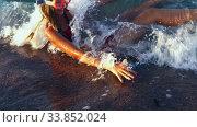 Купить «Beach vacation of girl sunburning by sea foam wave», видеоролик № 33852024, снято 22 мая 2020 г. (c) Gennadiy Poznyakov / Фотобанк Лори