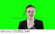 Купить «Anxious Caucasian woman looking at camera on green background», видеоролик № 33852344, снято 8 августа 2017 г. (c) Wavebreak Media / Фотобанк Лори