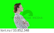Купить «Profile of a Caucasian woman on green background», видеоролик № 33852348, снято 8 августа 2017 г. (c) Wavebreak Media / Фотобанк Лори