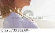 Купить «Caucasian woman holding sport mat on the beach and blue sky background», видеоролик № 33852604, снято 15 октября 2019 г. (c) Wavebreak Media / Фотобанк Лори