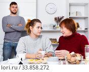 Купить «Woman calming girl during quarrel with boyfriend», фото № 33858272, снято 27 ноября 2017 г. (c) Яков Филимонов / Фотобанк Лори