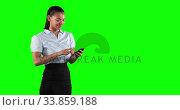 Купить «Animation of a mixed race woman in suit using a phone in a green background», видеоролик № 33859188, снято 24 октября 2018 г. (c) Wavebreak Media / Фотобанк Лори