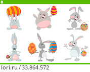 Cartoon Illustration of Funny Easter Bunnies on Easter Holiday Time with Colored Eggs Set. Стоковое фото, фотограф Zoonar.com/Igor Zakowski / easy Fotostock / Фотобанк Лори