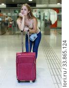 Купить «Woman on underground platform waiting train», фото № 33865124, снято 19 сентября 2018 г. (c) Яков Филимонов / Фотобанк Лори