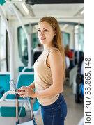 Купить «Woman traveling by subway train», фото № 33865148, снято 19 сентября 2018 г. (c) Яков Филимонов / Фотобанк Лори