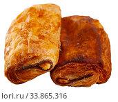 Купить «Neapolitan stuffed with ham and cheese closeup. Delicious breakfast concept», фото № 33865316, снято 3 июня 2020 г. (c) Яков Филимонов / Фотобанк Лори
