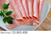 Купить «Sliced appetizing ham closeup wooden board», фото № 33865408, снято 31 мая 2020 г. (c) Яков Филимонов / Фотобанк Лори