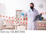 Купить «Doctor in virology concept at home», фото № 33867816, снято 1 апреля 2020 г. (c) Elnur / Фотобанк Лори