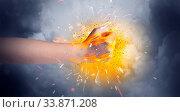 Купить «Hand hits strongly and makes fire beam around», фото № 33871208, снято 1 июня 2020 г. (c) easy Fotostock / Фотобанк Лори
