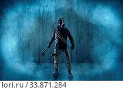 Купить «Dreadful dangerous man with wood, shanty wallpaper and fume around», фото № 33871284, снято 29 мая 2020 г. (c) easy Fotostock / Фотобанк Лори