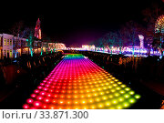 Купить «NAGASAKI, JAPAN - April 29, 2019 : Huis Ten Bosch is a theme park in Nagasaki, Japan, which displays old Dutch buildings and colorful lights show at night.», фото № 33871300, снято 29 апреля 2019 г. (c) easy Fotostock / Фотобанк Лори