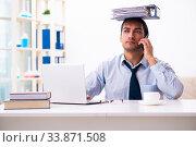 Купить «Young male employee working from house», фото № 33871508, снято 30 октября 2019 г. (c) Elnur / Фотобанк Лори