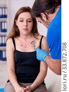 Купить «Young woman visiting male doctor dermatologist», фото № 33872708, снято 26 сентября 2019 г. (c) Elnur / Фотобанк Лори