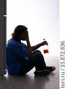 Купить «Young man suffering from alcoholism», фото № 33872836, снято 10 сентября 2019 г. (c) Elnur / Фотобанк Лори