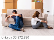 Купить «Young pair and many boxes in divorce settlement concept», фото № 33872880, снято 3 сентября 2019 г. (c) Elnur / Фотобанк Лори