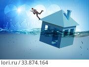 Купить «Mortgage repayment failure concept with man», фото № 33874164, снято 11 июля 2020 г. (c) Elnur / Фотобанк Лори