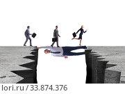 Купить «Businessman acting as a bridge in support concept», фото № 33874376, снято 6 июня 2020 г. (c) Elnur / Фотобанк Лори