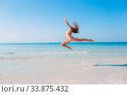 Купить «Adorable little girl have fun at tropical beach during vacation», фото № 33875432, снято 20 февраля 2020 г. (c) Дмитрий Травников / Фотобанк Лори
