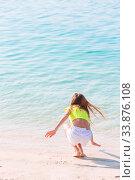 Купить «Adorable little girl have fun at tropical beach during vacation», фото № 33876108, снято 23 февраля 2020 г. (c) Дмитрий Травников / Фотобанк Лори