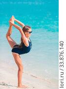 Купить «Adorable little girl have fun at tropical beach during vacation», фото № 33876140, снято 23 февраля 2020 г. (c) Дмитрий Травников / Фотобанк Лори