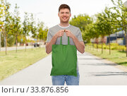 Купить «man with reusable canvas bag for food shopping», фото № 33876856, снято 21 марта 2020 г. (c) Syda Productions / Фотобанк Лори