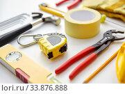 Купить «different work tools on white background», фото № 33876888, снято 26 ноября 2019 г. (c) Syda Productions / Фотобанк Лори