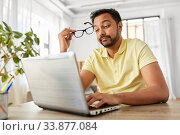 Купить «stressed man with laptop working at home office», фото № 33877084, снято 4 апреля 2020 г. (c) Syda Productions / Фотобанк Лори