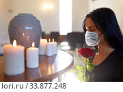 woman in mask with rose at funeral in church. Стоковое фото, фотограф Syda Productions / Фотобанк Лори