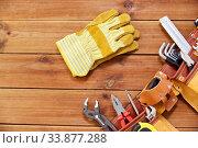 Купить «different work tools in belt on wooden boards», фото № 33877288, снято 26 ноября 2019 г. (c) Syda Productions / Фотобанк Лори