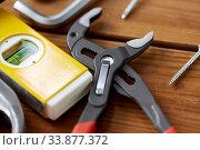 Купить «adjustable wrench and other different work tools», фото № 33877372, снято 26 ноября 2019 г. (c) Syda Productions / Фотобанк Лори