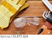 Купить «different work tools in belt on wooden boards», фото № 33877424, снято 26 ноября 2019 г. (c) Syda Productions / Фотобанк Лори