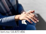 Купить «close up of woman cleaning hands with wet wipe», фото № 33877456, снято 8 апреля 2020 г. (c) Syda Productions / Фотобанк Лори