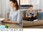 Купить «boy with gamepad playing video game at home», фото № 33877464, снято 10 апреля 2020 г. (c) Syda Productions / Фотобанк Лори