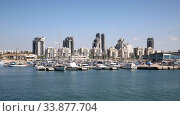 View of the city of Ashdod from the Mediterranean Sea on a sunny summer day. Israel. Стоковое видео, видеограф Наталья Волкова / Фотобанк Лори