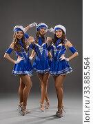 Купить «Showgirls in sailor style dresses shot», фото № 33885564, снято 12 апреля 2020 г. (c) Гурьянов Андрей / Фотобанк Лори