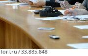 Купить «Hands of an official, businessman serving on the table. Meeting», видеоролик № 33885848, снято 29 мая 2020 г. (c) Mikhail Erguine / Фотобанк Лори