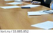 Купить «Hands of an official, businessman serving on the table. Meeting», видеоролик № 33885852, снято 29 мая 2020 г. (c) Mikhail Erguine / Фотобанк Лори