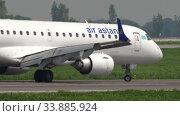 Купить «Air Astana Embraer taxiing», видеоролик № 33885924, снято 4 мая 2019 г. (c) Игорь Жоров / Фотобанк Лори