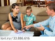 Купить «Woman with preteen son signing apartment lease», фото № 33886616, снято 4 июня 2020 г. (c) Яков Филимонов / Фотобанк Лори